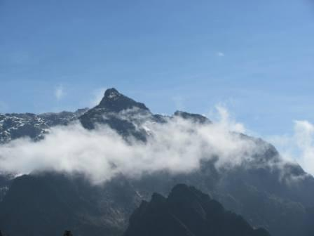 Rwenzori is the highest mountain range in Africa with the highest peaks; Margherita (5,109m) and Alexandra (5083m) on Mount Stanley. These are exceeded in altitude elsewhere in Africa only by Mt. Kilimanjaro and Mt. Kenya which are extinct volcanoes standing in isolation above the surrounding plain